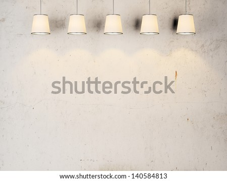 vintage wall with lamps - stock photo