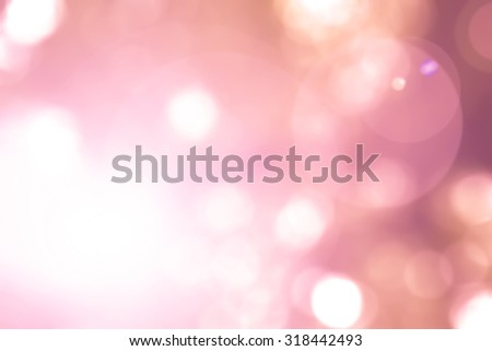Vintage warm red orange color tone blurred nature background of a view looking up through red autumn foliage of a tree against the sky facing sun flare and bokeh: Blurred natural greenery bokeh - stock photo
