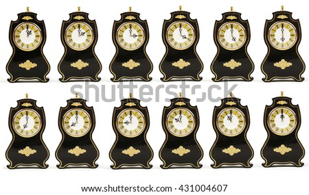 Vintage watch in black on white background. Retro table clock with hands. - stock photo