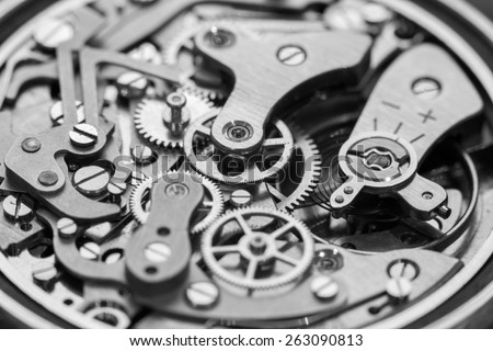 Vintage watch movement close-up. Showing cogs, wheels and jewels. - stock photo