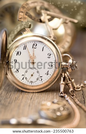 Vintage watch on a festive background showing five to twelve, Happy New Year! - stock photo