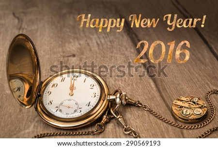 "Vintage watch on a wooden background showing five to twelve and caption ""Happy Year 2016"" - stock photo"