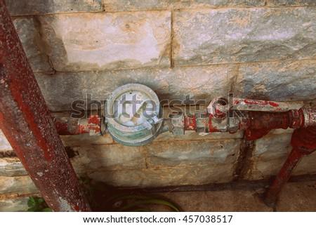 Vintage water meter - stock photo