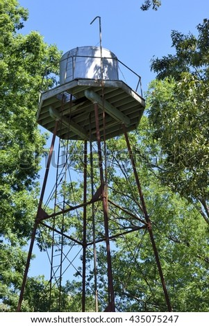 Vintage water tank tower at rural Georgia, USA - stock photo