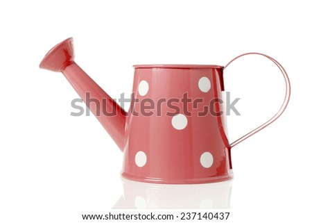Vintage watering can with red color and polka dots isolated on white background. - stock photo
