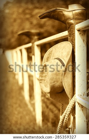 Vintage western ranch background with cowboy boots and hat - stock photo
