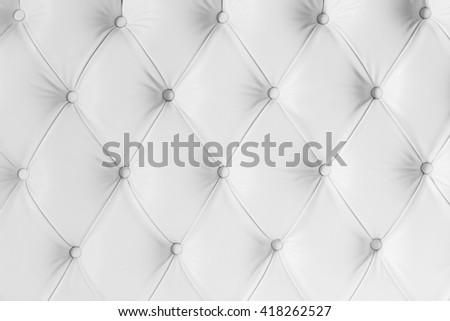 Vintage white leather texture sofa for background. - stock photo