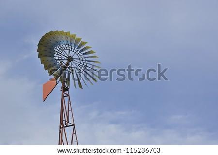 Vintage windmill on sky background. - stock photo
