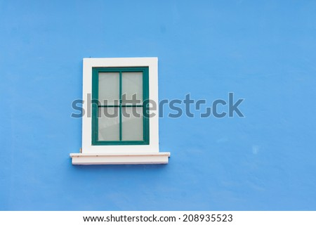 vintage window on color wall - stock photo