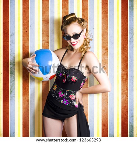 Vintage Woman Holding Colourful Beach Ball On Retro Background - stock photo
