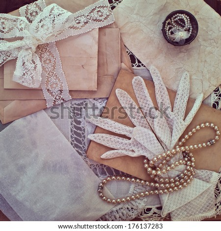 Vintage women's jewelry and gloves. Bundle of old letters with lace ribbon - stock photo