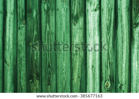 Vintage wood background. Grunge wooden weathered oak or pine textured planks. Rustic green rustic fence. - stock photo