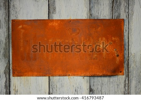 vintage wood barn door texture background with rusty plate - stock photo