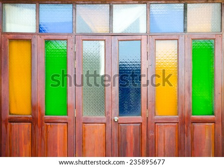Vintage wood doors with colorful glass - stock photo