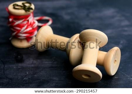 Vintage wooden bobbin thread - stock photo