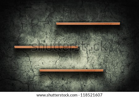 Vintage wooden bookshelf over a grungy background - stock photo