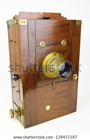 Vintage wooden camera isolated - stock photo