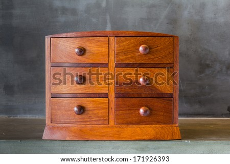 Vintage wooden chest with drawer on shelf - stock photo