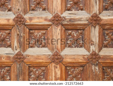 Vintage wooden door, medieval architecture. Part of a door of old castle. Wood and metal  - stock photo