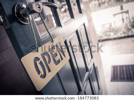 Vintage wooden door open sign and handle - stock photo