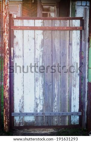 Vintage wooden door with copy space - stock photo