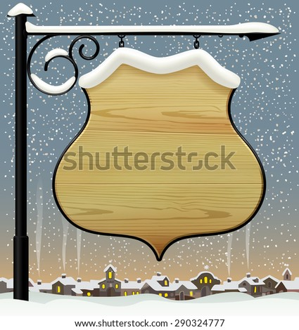 Vintage wooden street  signboard hanging on forged brackets against the winter old city. background - stock photo