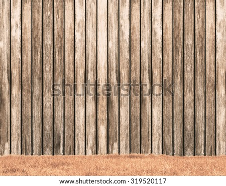 vintage wooden wall on orange field background - stock photo