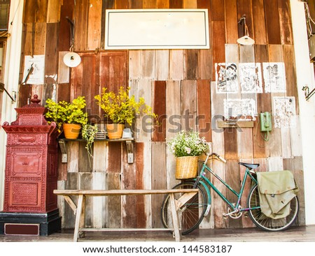 vintage wooden wall with vintage accessories foreground. - stock photo