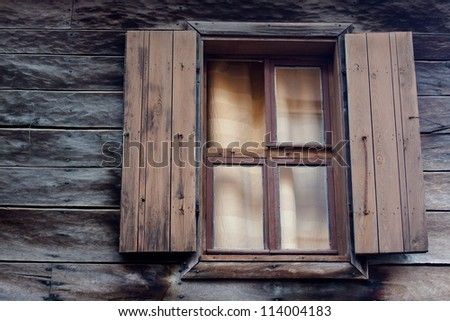 Vintage wooden window on old grunge wall - stock photo