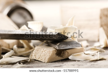 Vintage woodworking tools on dirty workbench - stock photo