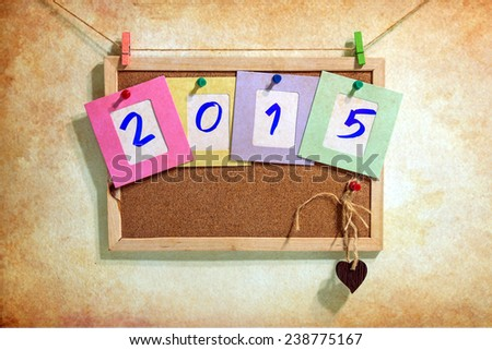 Vintage 2015 write on paper photo frame over wall background, New year concept - stock photo