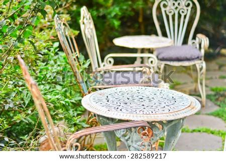 Vintage wrought iron garden table - stock photo