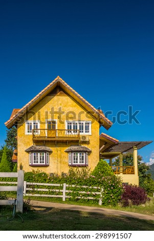 Vintage yellow European style house in countryside of Mae Hong Son province, Northern Thailand - stock photo