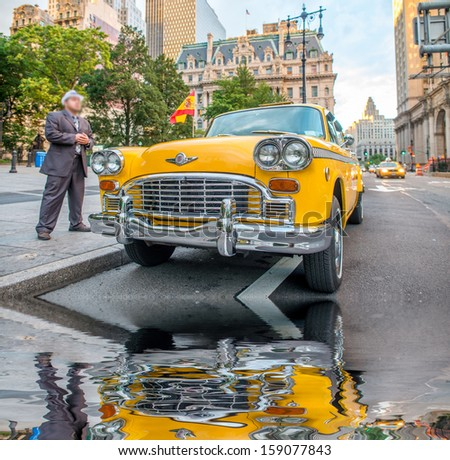 Vintage yellow taxi in New York streets with driver waiting for customers. - stock photo