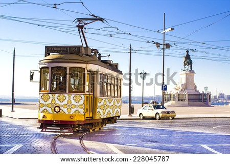 Vintage yellow tramway at the Commerce Square in Lisbon, Portugal - stock photo