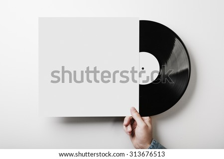 Vinyl cover on white wall background - stock photo
