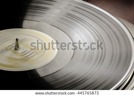 Vinyl LP on a turntable. - stock photo