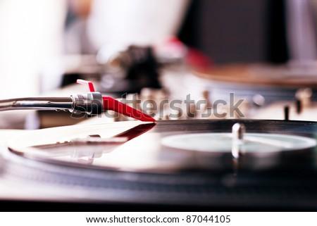 Vinyl record spinning on DJ player - stock photo