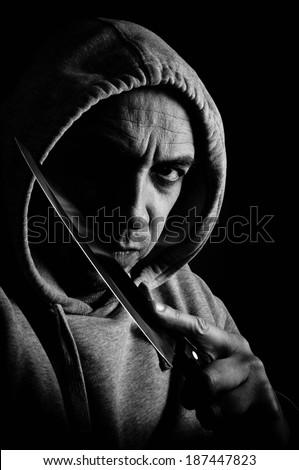 Violent man holding a knife - stock photo