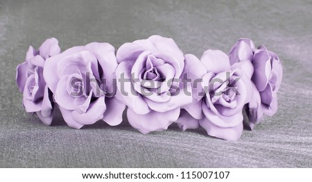 violet beige rose in the wedding crown with pink the centers fresh from a cold porcelain on the grey fabrics pearl tint - stock photo