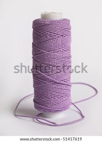 violet bobbin - stock photo