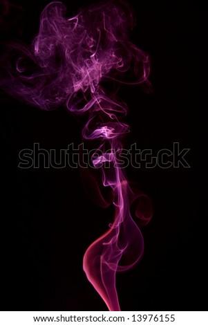 Violet colored smoke on black background - stock photo