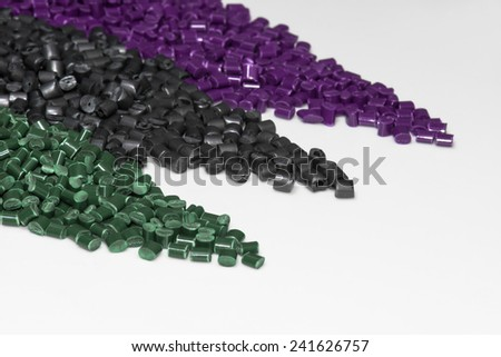 violet, grey and green polymer resin on white table for background - stock photo