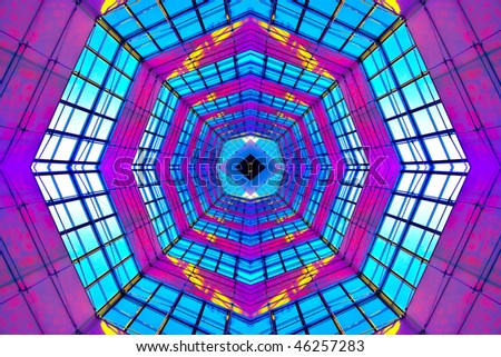 Violet illuminated ceiling indoor shopping mall - stock photo