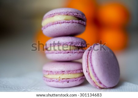 Violet macarons, shallow dof - stock photo
