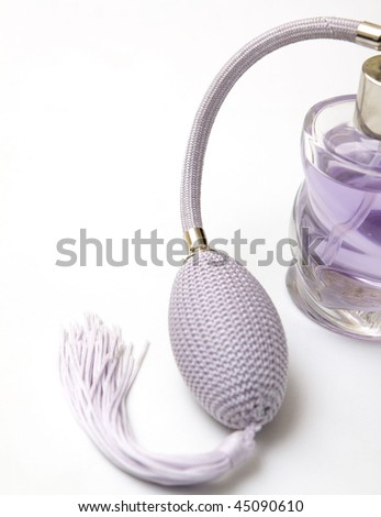 Violet perfume on white background - stock photo