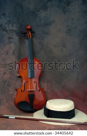 Violin and a cap - stock photo