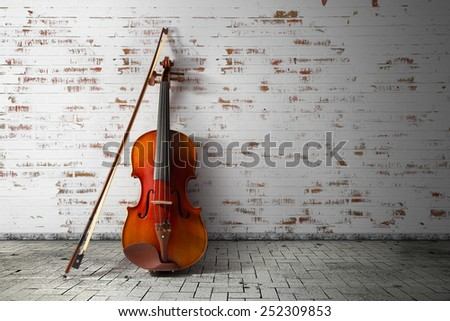 Violin and bow on vintage background - stock photo