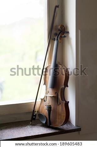 Violin beside window light close up shoot - stock photo