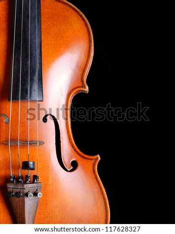 Violin close-up on black background - stock photo